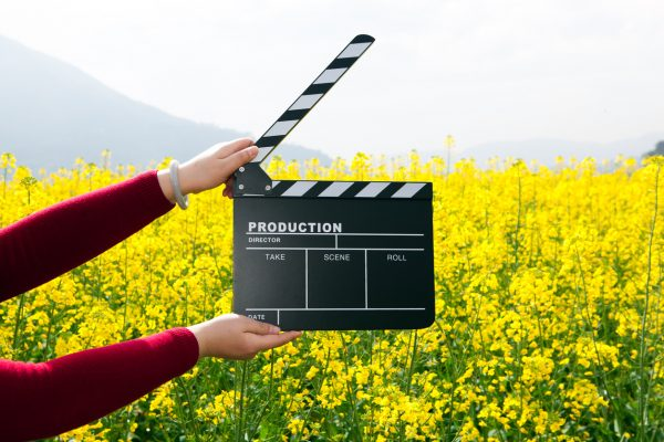 clapper board with hand